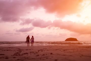 Silhouette of couple at the sunset Kata beach, Phuket, Thailand