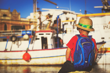 little boy looking at port in Malta