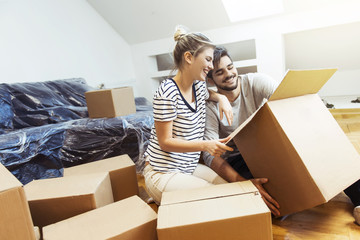Young couple moving into their new home
