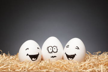 Funny little Easter Egg Stories, hand drawn faces  with expression: One Scared, Two Smiling