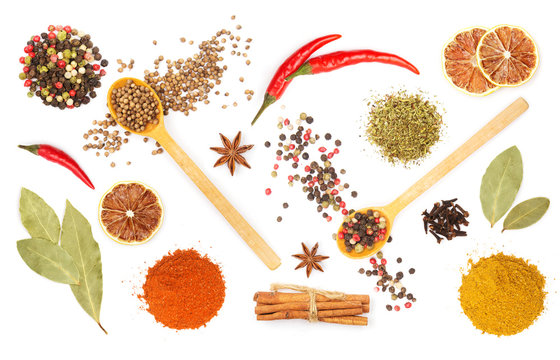 Colorful spices and herbs for cooking background and design isolated