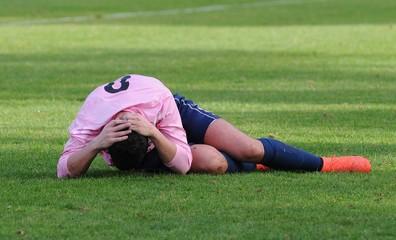 la douleur du joueur au football