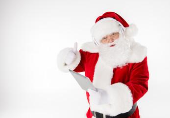 Santa Claus listening music with headphones