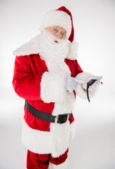 Santa Claus pointing on smartwatch