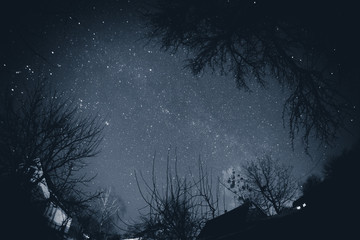Starry sky above the village