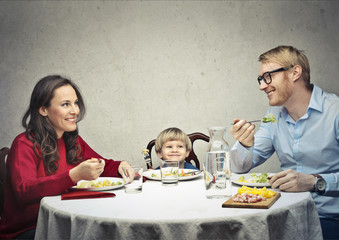 Happy family eating
