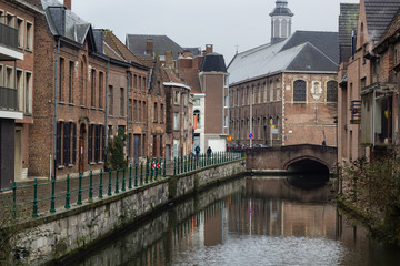 View of canals and  streets of Gent town, Belgium in rainy day in winter
