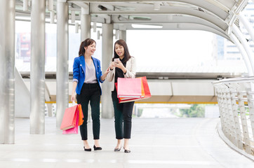 Happy shopping asia women with shopping bags walking at the mall.