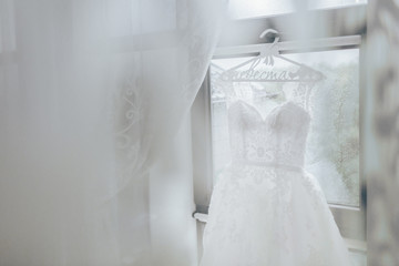 Wedding dress hanging on a window