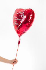 Valentine's day, birthday, love concept. Red heart shaped balloon with words I love you on white background