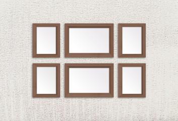 Wooden photo frames set on textured wallpaper. Interior decor mock up