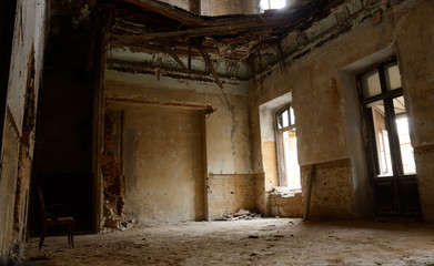 Empty room with chair in old ruined abandoned building,Odessa,Ukraine,Europe