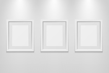 Empty picture frames on the wall with light effect, vector illustration