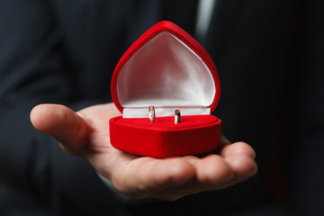 Wedding rings in red heart shaped box