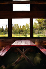 Picnic table in wooden shelter