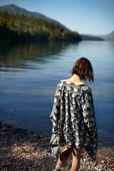 Rear view of woman walking towards lake