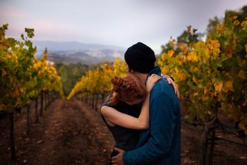 Man and woman embracing in vineyard
