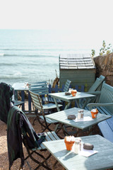 Tables and chairs at seaside cafe