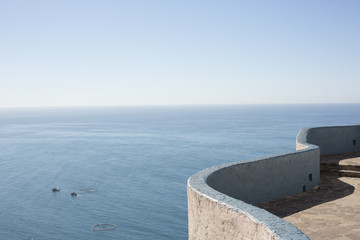 Edge of wall with view of sea and horizon