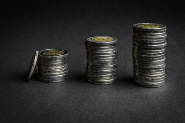 Stack of coins on dark background (Polish Five Zloty coins) - business concept