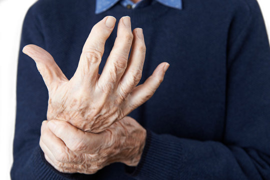 Close Up Of Senior Man Suffering With Arthritis