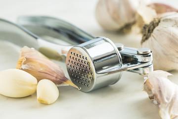 Garlic and garlic press.
