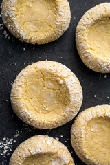 Moroccan semolina and almond cookies on plate, overhead view