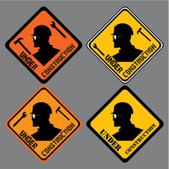 under construction sign. construction worker head, wrench and hammer. caution sign board