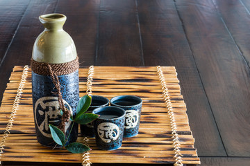 Japanese sake set on the bamboo mat.