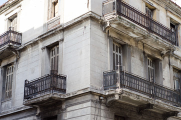 New classic house in athens first floor with crafted iron handrails, marble balconies, wooden windows viewing angle