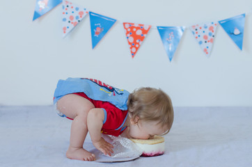 One year old baby eating cake