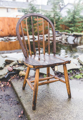 Wooden chair in wet back yard