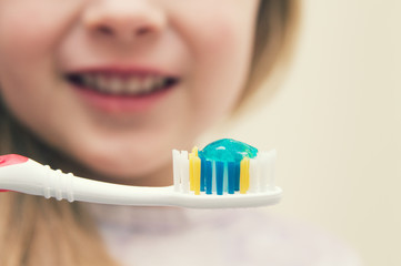 Close up of little girl with toothbrush