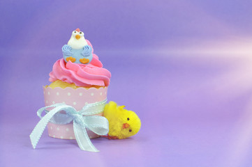 Happy Easter pink, yellow and blue cupcakes