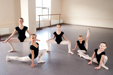 A group of children engaged in choreography.