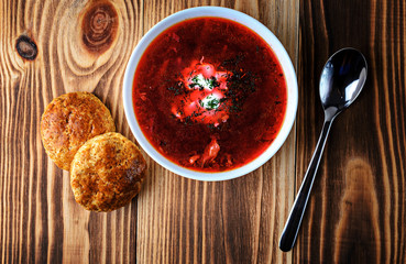 Borscht or soup on a wooden background