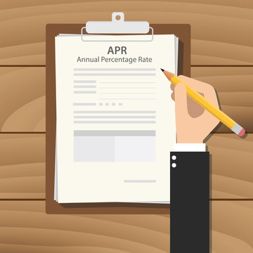 apr annual percentage rate illustration concept with hand business man signing a paperwork document on top of the table