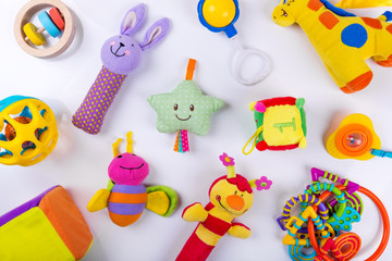 colorful baby toys on white. top view