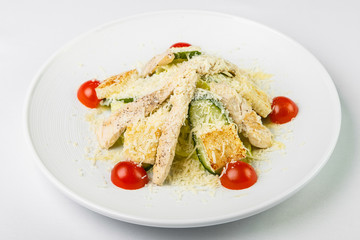 Salad with chicken and vegetables sprinkled with cheese in circu