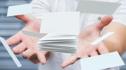 Businessman holding floating business card 3D rendering