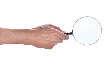 man hand holding magnifying glass isolated on white background