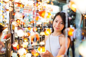 Woman buying the lantern in street market