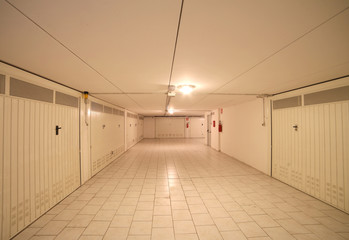 basement garage in an underground parking lot of the apartment b