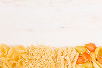 Pasta background decorative border of assortment different kinds italian macaroni. Healthy traditional food backdrop.