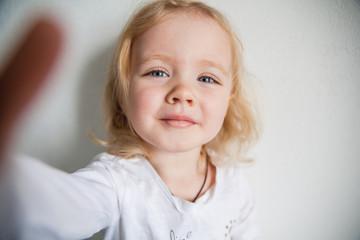 a beautiful little girl making a selfie