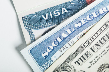 US Visa, Social Security Card and one dollar bill