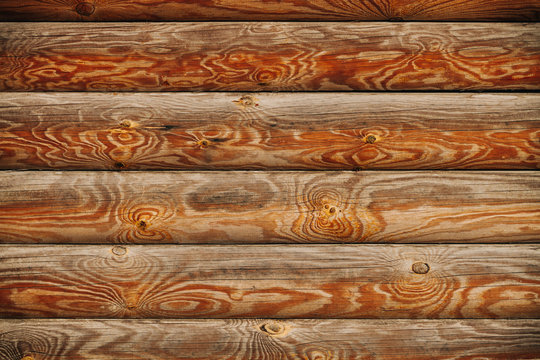 a wall of wood , horizontal wood logs , wood texture , place for text , copy space