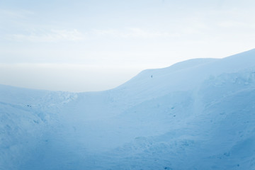 A beautiful, minimalist landscape of snowy Norwegian hills. Clean, light, high key, decorative look.