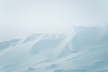 A beautiful, minimalist landscape of snowdrift in Norway. Clean, light, high key, decorative look.