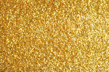Sprinkle glitter gold dust on a black background with copy space Wall mural